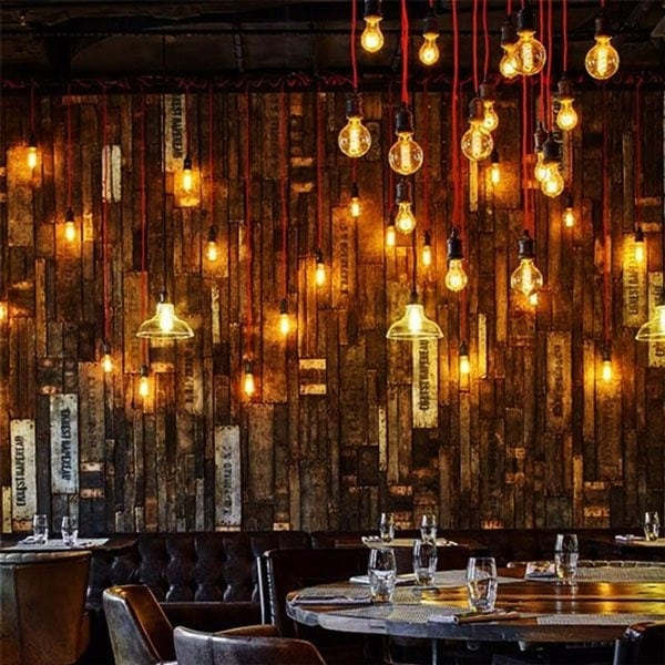 Dining room filled with hanging vintage Filament bulbs