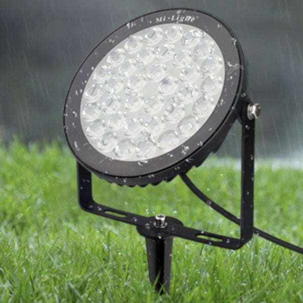 Waterproof outdoor Floodlight on grass in the rain