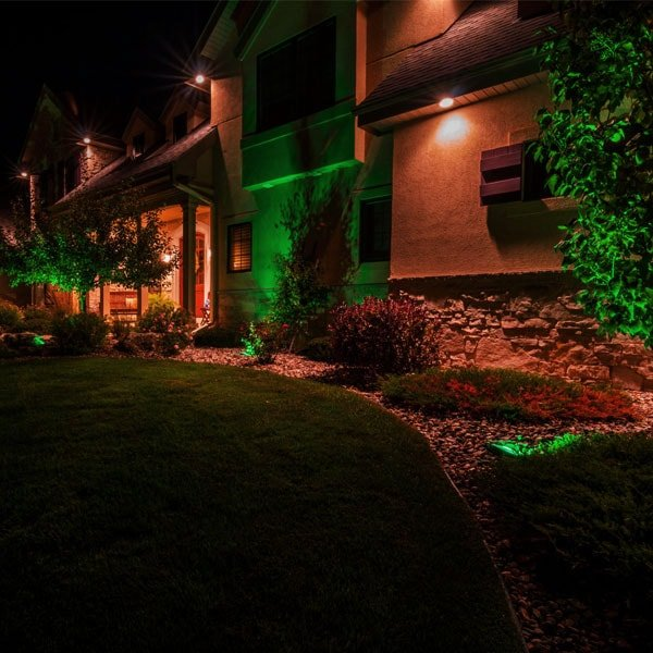 Large house with outdoor lighting in the garden