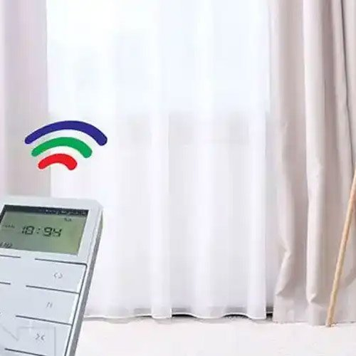 white remote control for smart curtain track.